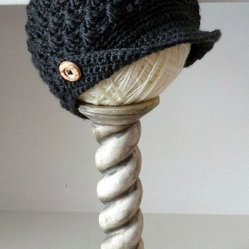 Dark gray bobbled woman's newsboy hat with fold-up corner brim and wooden buttons