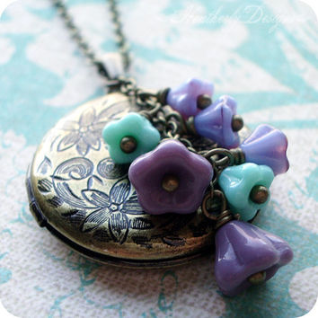 Clematis by Night: czech glass flower beads and etched brass locket necklace