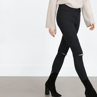 """HIGH ELASTICITY"" JEGGINGS. KNEE RIPS"