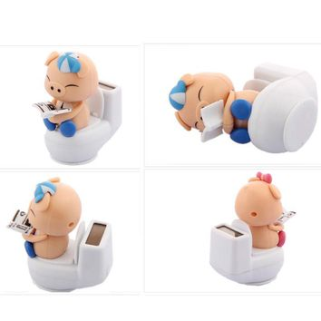 Reading on Toilet Bowl Pig Solar Toy Auto Styling Car Dashboard Office Decor Ornament