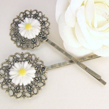 Bronze bobby pins with white daisy flower and filigree