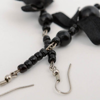 Handmade evening long dangle earrings with black beads and satin ribbon bows