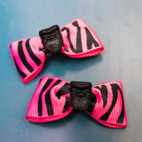 Pink Tiki Zebra bows from Plumeria M. Accessories
