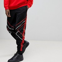 ASOS x Star Wars Poly Tricot Joggers With Printed Tape at asos.com