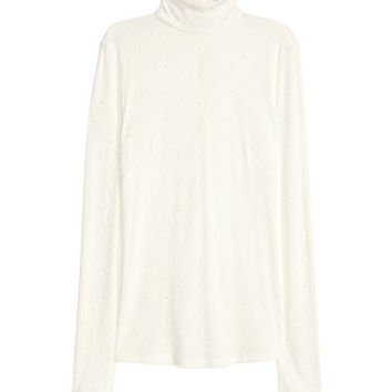 H&M Studded Turtleneck Top $49.99