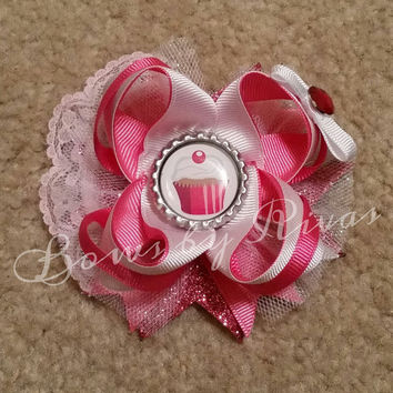 Pink, Silver, and White Boutique Stacked Hair Bow with Lace, Tulle, and Bottle Cap Image of a Cupcake