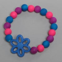 Colorful homemade children's wrist bracelet with plastic beads and flower