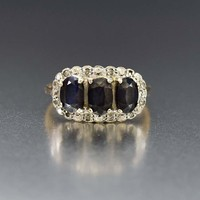 Breathtaking Three Stone Sapphire and Diamond Ring