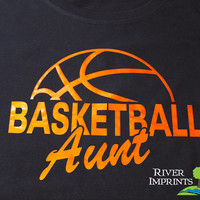 BASKETBALL AUNT cursive, shiny foil t-shirt with your choice of color-- fitted, regular, or long sleeve