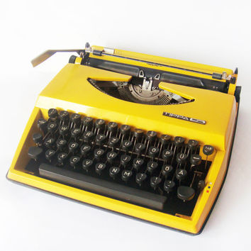 Bright Yellow Triumph Typewriter Tippa Adler  made in by wwvintage