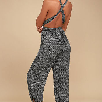 Take a Trip Black Print Halter Jumpsuit