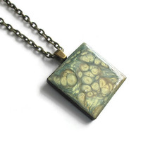 Sage Green and Gold Pendant Necklace, hand painted wooden tile pendant with metallic green and gold abstract design, antiqued brass necklace