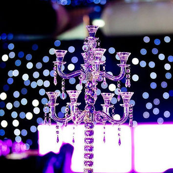Lavish Crystal Candelabra 26 inches tall wide with 9 arms and hanging crystals. Lavish candelabra wedding centerpiece set of 10