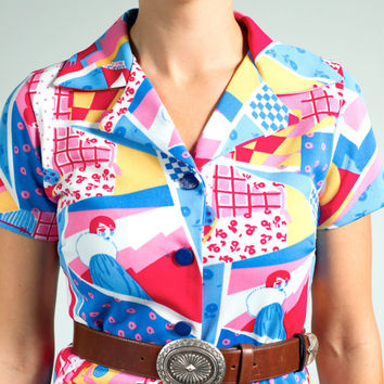Vtg MOD print short sleeve shift dress with button front, butterfly collar