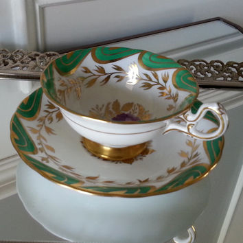 Antique large Royal Chelsea green and gold gilt tea cup and saucer set with pink and purple flowers