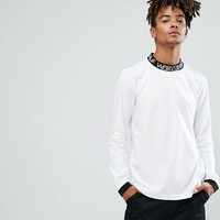 HUF Letras Long Sleeve T-Shirt With Contrast Logo Collar at asos.com