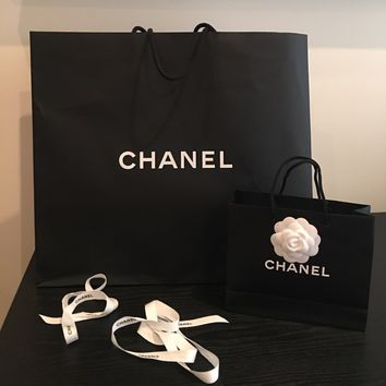 Authentic Chanel shopping bags and ribbon
