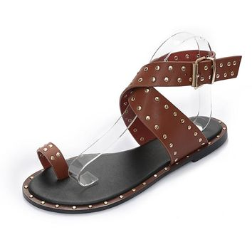 Leather gladiator sandals with studs & cross over straps