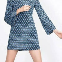 Retro Print Open Back Mini Dress in Blue