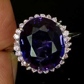 A Vintage 14K White Gold 7.25CT Oval Cut Royal Blue Sapphire Halo Ring