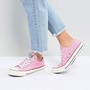 Converse Chuck Taylor All Star Ox Sneakers In Stonewashed Pink at asos.com