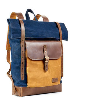 Navy blue waxed canvas backpack. Waxed canvas leather backpack.
