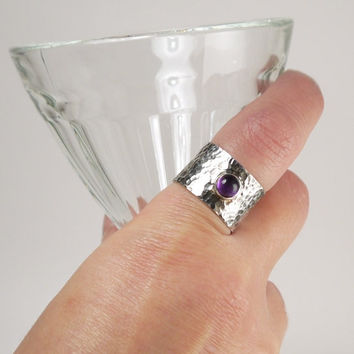 Hammered sterling silver wide band with cabochon amethyst stone