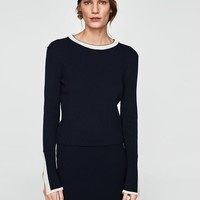 CONTRASTING RIBBED SWEATER DETAILS