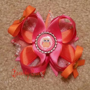 Pink and Orange Boutique Stacked Hair bow with Glitter Tulle, Rhinestones, and Bottle Cap Image of an Owl