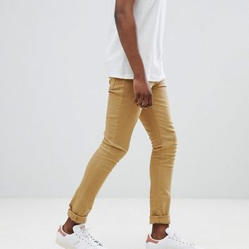 ASOS DESIGN Super Skinny Jeans In Stone at asos.com