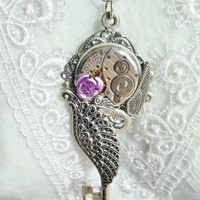Steampunk necklace, silver wing necklace with Elgin watch movement.