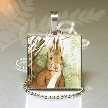 Benjamin Bunny sitting at the bank close up 1 inch glass necklace or keychain