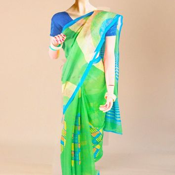 the contemporary goergette print saree in vibrant green with blue trim