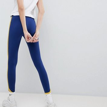 Nike Archive Leggings In Blue With Piped Trim at asos.com