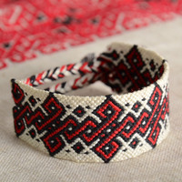 Handmade friendship wrist bracelet woven of threads in ethnic Ukrainian style