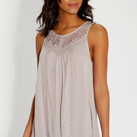 sleeveless lacy top with shark bite hem