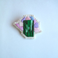 Abstract mineral brooch gem inspiration hand embroidered in ombre green with pink and lavender thread on cream muslin and cream felt OOAK