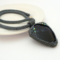 Bead crochet necklace, blue goldstone pendant, hematite colors, elegant