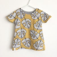 Toddler tunic dress with short sleeves. Summer dress. Yellow organic jersey fabric with leaves. Girls dress. Yellow cotton with monstera