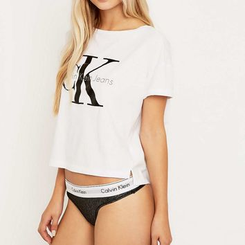 Calvin Klein Black Foil Thong Knickers - Urban Outfitters