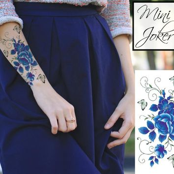 Mini Joker | Awesome Tattoos Blue Roses W/ Butterfly Tattoo