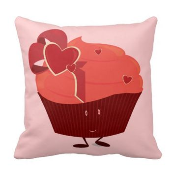 Smiling cupcake with heart decoration pillows
