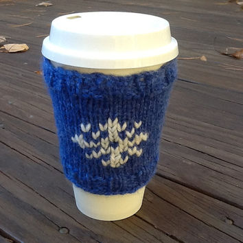 Coffee Cup cozy knitted in blue yarn with white snowflake for standard 16 oz.  travel cup, washable cup sleeve, winter design