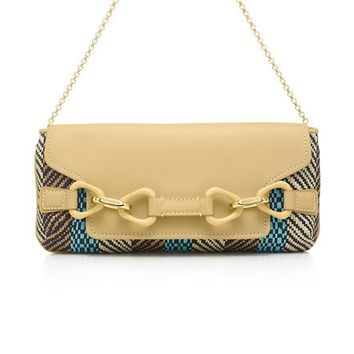 Tiffany & Co. -  Babette clutch in striped raffia and patent leather. More colors available.
