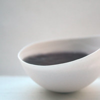 Stoneware fine bone china bowl with a pool of purple resin.