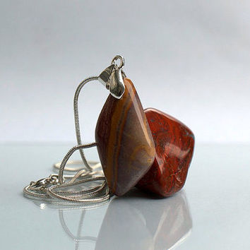 Rhyolite Wonderstone free form gemstone pendant with silver plated bail and necklace