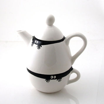 Teapot and cup with peeping monster eyes