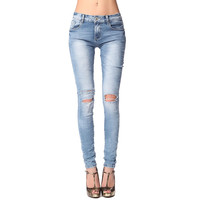 Skinny jeans with knee rips
