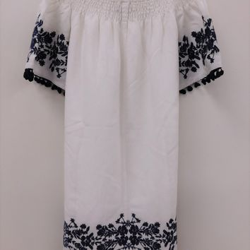 White Off the Shoulder Short Sleeve dress with navy floral embroidery and navy pom poms