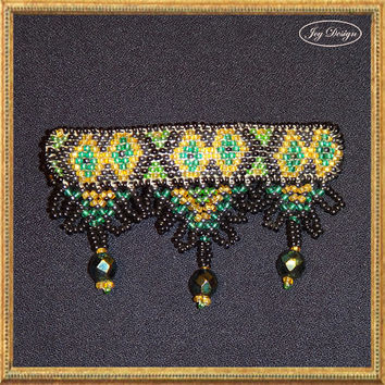 BRIDGETTE is a vintage barrette decorated with loomed black, gold and green glass seed beads